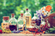 bottles-of-tincture-and-dry-healthy-herbs-thumbnail