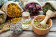 healing-herbs-in-hessian-bags-mortar-with-chamomile-and-essenti-thumbnail